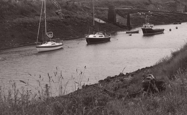 3 boats near the mouth of the Afon Afan