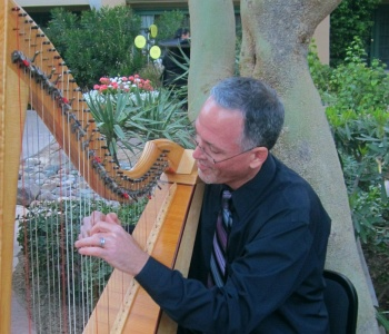 John Piggott playing his harp